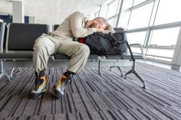 Airport traveller sleeping