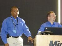 Gomez, left, and David Musgrave present at the 2011 event